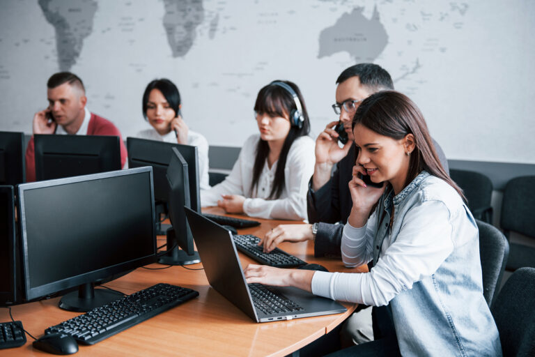 Everyone doing his job. Young people working in the call center. New deals is coming