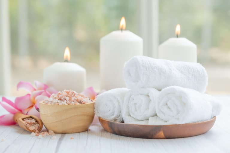 Natural relaxing spa composition on massage table in wellness ce